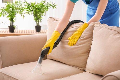 How do you clean a fabric sofa