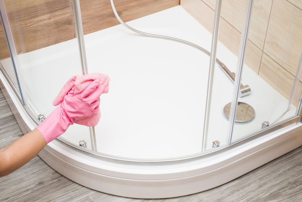 What do professional cleaners use to clean showers?